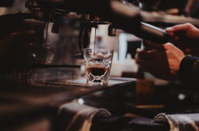 espresso machine pouring espresso into glass